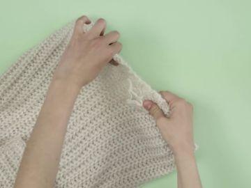 Cómo reparar un enganchón en un jersey de lana